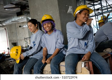 Bangkok, Thailand - November 10, 2008 :  On a building site in Bangkok during lunch time, some women workers have a break,  Most workers come from the north east of Thailand, Cambodia and Myanmar.