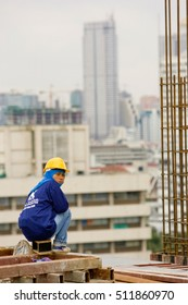 Bangkok, Thailand - November 10, 2008 :  Workers on a building site in Bangkok. Salaries are very low for a dangerous and tiring work. Most workers come from  Thailand, Cambodia and Myanmar.