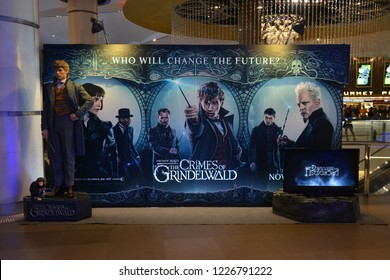 Bangkok, Thailand – November 10, 2018: Statue of Newt Scamander (Eddie Redmayne) with The Standee of Movie Fantastic Beasts 2 : The Crimes of Grindelwald from the writer of Harry Potter film series J.