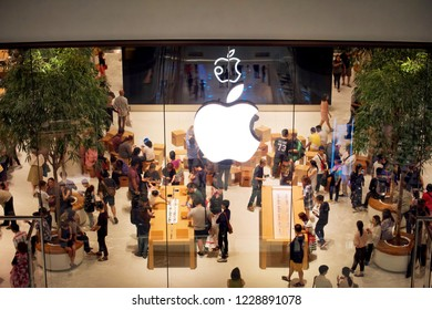 Bangkok, Thailand - November 10 2018: Many people is view products (iPhone, iPad, iMac, MacBook, Apple Watch, AirPods) in Apple Iconsiam or Apple Store Thailand on the first day. Night time.