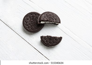 Bangkok, Thailand - November 11, 2016. Oreo Cookies,a bite on chocolate cookie and cream on white wood table