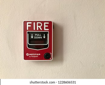 BANGKOK, THAILAND - NOVEMBER 11, 2018: The fire alarm, notifier by Honeywell, set on a white concrete wall in a building to warn when there is a fire.