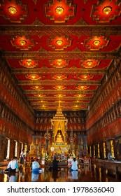 Bangkok, Thailand - November 11 2019: Unidentified people pay respect to the Buddha Sihing statue inside the Phutthai Sawan Throne Hall at Bangkok National Museum