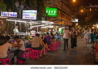 BANGKOK, THAILAND - NOVEMBER 13, 2015: Tourists and backpackers walk in Khao San Road, famous low budget hotels and guesthouses area in Bangkok.