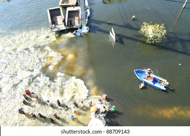 BANGKOK, THAILAND - NOVEMBER 13: Boat is passing through water barrier after barrier are destroyed during the worst monsoon flooding in decades in Bangkok, Thailand on November 13, 2011.