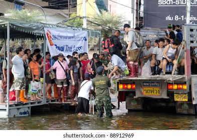 BANGKOK THAILAND – NOVEMBER 13: Truck carries a group of people to evacuate from the flooded area at Phahon Yothin Road during the massive flood crisis on November 13, 2011 in Bangkok, Thailand.