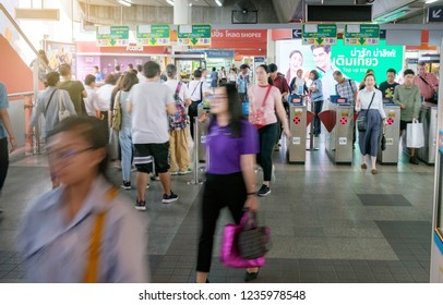 BANGKOK, THAILAND - November 13: Victory Monument BTS Station on November 13,2018 in Bangkok, Thailand. crowded people and security at an entrance gate with key card access control into BTS Sky train