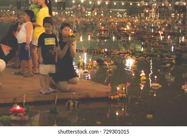 BANGKOK, THAILAND - November 14, 2016: People float lanterns in the river to worship river goddess in Loy Kratong festival at The Government Public Relations Department.