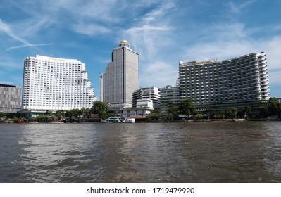 BANGKOK, THAILAND - NOVEMBER 14, 2019: State Tower skyscraper and Shangri-La Hotel, located in Bang Rak district of Bangkok, Thailand. Seen from the Chao Phraya River.