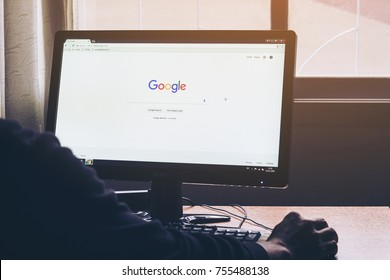 Bangkok, Thailand - November 15, 2017: Man on a computer Browsing Google is the biggest Internet search engine in the world.