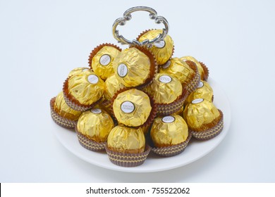 BANGKOK THAILAND - November 15, 2017: A box of Ferrero Rocher Chocolates. Since 1982, the candy consists of a whole roasted hazelnut in a thin wafer shell filled with hazelnut cream coated in milk cho