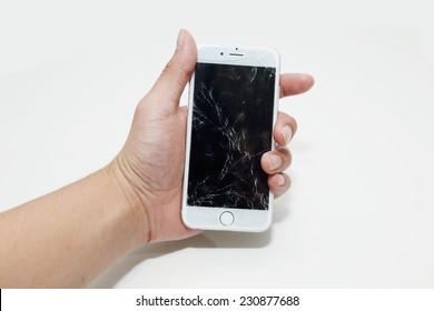 BANGKOK, THAILAND -NOVEMBER 16, 2014: hand hold the new apple iphone6 with broken sceen on 16 November 2014 in Bangkok Thailand.