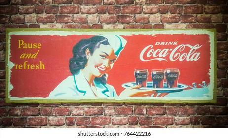 BANGKOK -THAILAND, NOVEMBER 16,2017 : Old condition vintage wall of Coca-Cola logo. on November 16, 2017 in Bangkok Thailand.