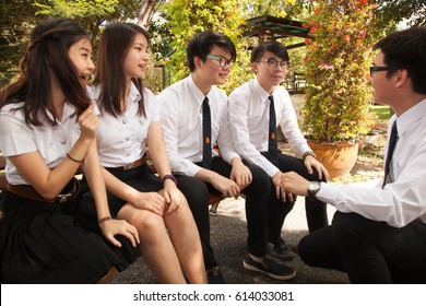 Bangkok, Thailand - November 17, 2015 :  King Mongkut's Institute of Technology Ladkrabang is a research and educational institution A group of students have fun talking and playing in the garden.