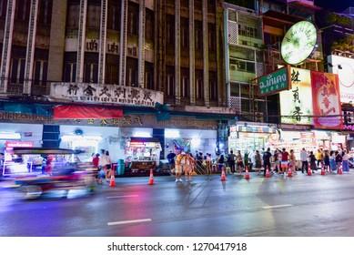 Bangkok, Thailand - November 17, 2018: Old Shophouses and Tourists on Yaowarat Road or the Chinatown of Bangkok