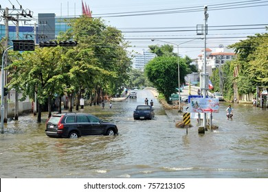 Bangkok, Thailand - November 18, 2011: Traffic moves along a flooded road as Thailand experiences its most severe flooding in decades.