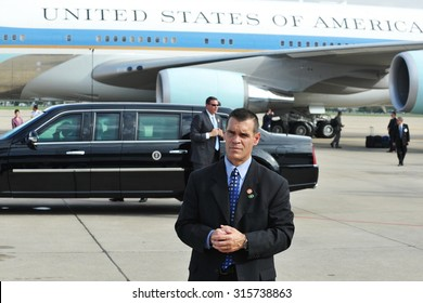 Bangkok, Thailand - November 18, 2012: A body guard waits by the Presidential State Car and Air Force One at an airport as President Barack Obama begins his historic SE Asia tour.