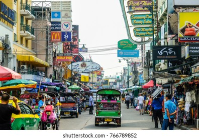 BANGKOK, THAILAND - NOVEMBER 18, 2017: Tourists and locals walk along popular backpacker destination Khao San Road. The area is famous for its street market in Thailand.