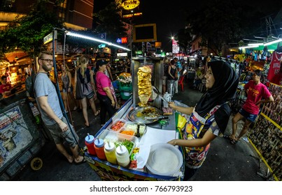 Bangkok, Thailand - November 18, 2017 : Muslim hawkers sell kebab near Khao San Road, Khao San road is a famous place for sight-seeing and eating in Bangkok.