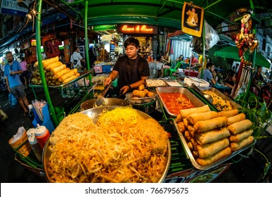 Bangkok, Thailand - November 18, 2017 : Local hawkers sell Phad Thai noodle near Khao San Road, Khao San road is a famous place for sight-seeing and eating in Bangkok.
