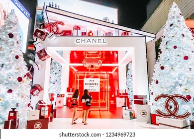BANGKOK, THAILAND - NOVEMBER 18, 2018: Luxury brand Channel revealed the No.5 limited edition outdoor booth features white Christmas trees and large gift boxes in Bangkok, Thailand.
