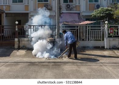 Bangkok, Thailand - November 19, 2016 : Unidentified people fogging DDT spray kill mosquito for control Malaria, Encephalitis, Dengue and Zika in village at Bangkok Thailand.