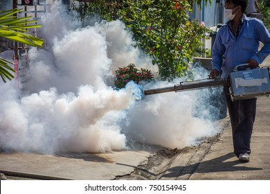 Bangkok, Thailand - November 19, 2016 : Unidentified people fogging DDT spray for mosquito kill and protect by control mosquito is a carrier of Malaria, Encephalitis, Dengue and Zika virus in village.