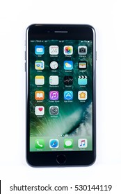 BANGKOK, THAILAND - NOVEMBER 20, 2016: Iphone 7 Plus jet black series front view with default home scren on white plain floor, new generation of smartphone, smartphone without headphone jack
