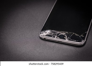 Bangkok, Thailand - November 20, 2017: Photo of iPhone 6 plus with broken display. Modern smartphone with damaged glass screen  on black background. Device needs repair.