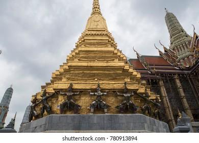 Bangkok, Thailand - November 20, 2017: The monkey-demon statues of golden tower at Wat Phra Kaew.