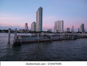 BANGKOK, THAILAND - NOVEMBER 20, 2019: WATERMARK Chaophraya River condominium complex, evening view from Asiatique The Riverfront pier in Bangkok, Thailand.
