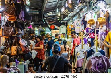 BANGKOK, THAILAND - NOVEMBER 2018: Group of people at the night market in Bangkok, Thailand