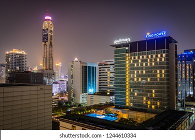 BANGKOK, THAILAND - NOVEMBER 2018: Bangkok lights at night from the roof of one of hotels - skyscrapers, windows and roof pool in Thailand