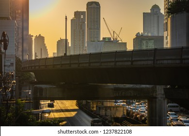 BANGKOK, THAILAND - NOVEMBER 2018: Orange sunset over the street of Bangkok and the skytrain railroad, Thailand