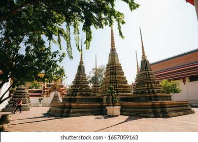 Bangkok, Thailand - November, 2019 : People tourists visiting WAT PHRA KAEW (Thai Emerald Buddha temple) in the sunny day. Phra Maha Chedi Si Ratchakan