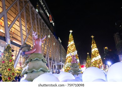 BANGKOK, THAILAND - NOVEMBER 21, 2017: Merry Christmas and Happy New Year 2018 event is showing at CentralWorld, the popular shopping mall in Thailand with many people to take a photo at night.
