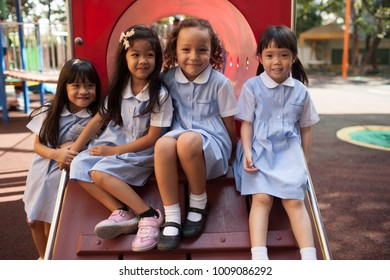 BANGKOK, THAILAND - NOVEMBER 22, 2012: In a college in Bangkok, children have fun in the playground during the break