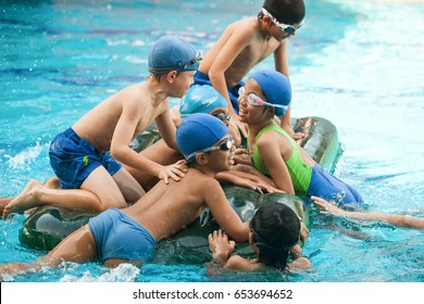 Bangkok , Thailand â?? November 22, 2012: In a school in Bangkok, school children have fun in a swimming pool during a swimming lesson.