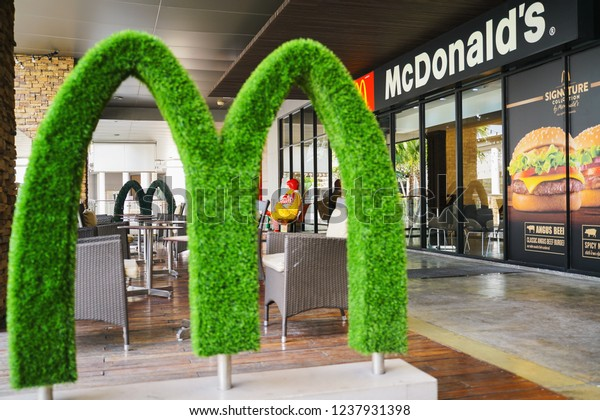 BANGKOK ,THAILAND- November 22,2018: the back side of Ronald Mc Donald in front of Mc Donald's restaurant with blurred green M alphabet