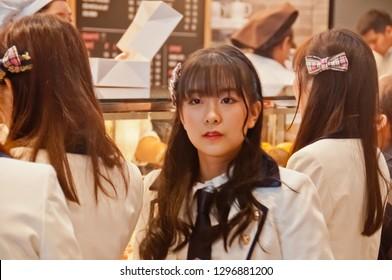BANGKOK, THAILAND - NOVEMBER 23, 2018: Nannaphas Loetnamchoetsakun (Mewnich), a member of Thai Idol girl group BNK48, smiles at the  fanclub in Gontran Cherrier bakery grand opening public event.