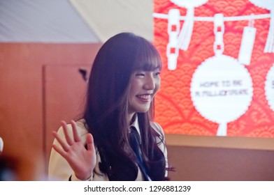 BANGKOK, THAILAND - NOVEMBER 23, 2018: Dusita Kitisarakulcha (Natherine), a member of Thai Idol girl group BNK48, smiles to greet fanclub in Gontran Cherrier bakery grand opening public event