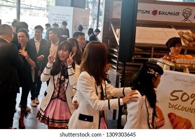 BANGKOK, THAILAND - NOVEMBER 23, 2018: Dusita Kitisarakulcha (Natherine), a member of Thai Idol girl group BNK48, show Victory signs by 2 hands to greet  fanclub in Gontran Cherrier bakery event