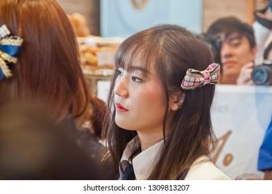 BANGKOK, THAILAND - NOVEMBER 23, 2018: Dusita Kitisarakulcha (Natherine), a member of Thai Idol girl group BNK48, looks with curiosity to see  fanclub in Gontran Cherrier bakery grand opening event