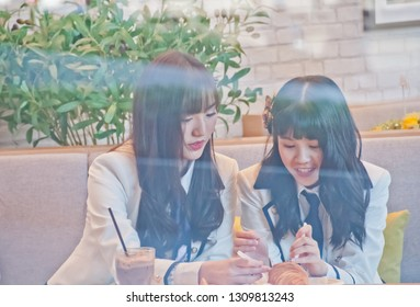 BANGKOK, THAILAND - NOVEMBER 23, 2018: Natherine and Ratah, members of Thai Idol girl group BNK48, eat breakfast before attending Gontran Cherrier bakery grand opening public event