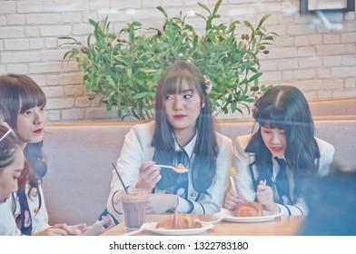 BANGKOK, THAILAND - NOVEMBER 23, 2018: Natherine, Ratah, Pukkhom, members of Thai Idol girl group BNK48, eat breakfast before attending Gontran Cherrier bakery grand opening public event.