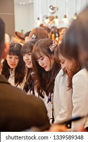 BANGKOK, THAILAND - NOVEMBER 23, 2018: A group members of Thai Idol girl group BNK48, smile at a menu in Gontran Cherrier bakery grand opening public event. There are many fanclub and members in photo