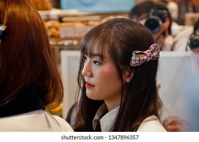 BANGKOK, THAILAND - NOVEMBER 23, 2018: Dusita Kitisarakulcha (Natherine), a member of Thai Idol girl group BNK48, looks with curiosity to see  fanclub in Gontran Cherrier bakery grand opening event.