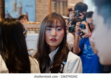 BANGKOK, THAILAND - NOVEMBER 23, 2018: Dusita Kitisarakulcha (Natherine), a member of Thai Idol girl group BNK48, looks with curiosity to see  fanclub in Gontran Cherrier bakery opening public event.