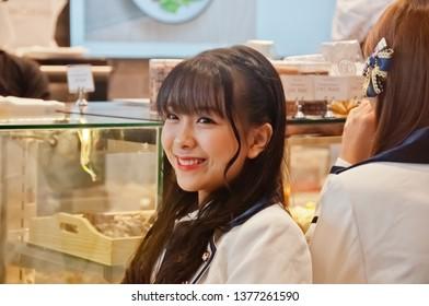 BANGKOK, THAILAND - NOVEMBER 23, 2018: Nannaphas Loetnamchoetsakun (Mewnich), a member of Thai Idol girl group BNK48, smiles and laught at the  fanclub in Gontran Cherrier bakery grand opening