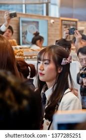 BANGKOK, THAILAND - NOVEMBER 23, 2018: Dusita Kitisarakulchai (Natherine), a member of Thai Idol girl group BNK48, looks with curiosity to see  fanclub in Gontran Cherrier bakery grand opening event